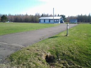Land and Garage for sale