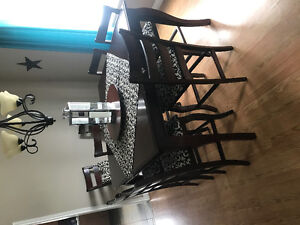 Pub style table set with eight chairs