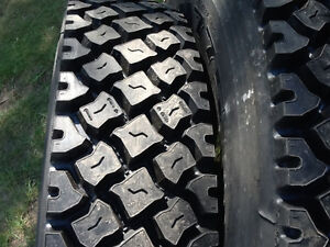 11R22.5 New retreads mounted on used aluminum wheels. Four tires