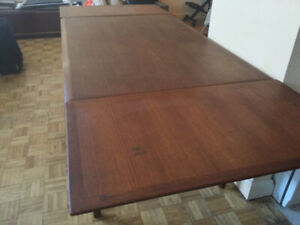 ! beautiful teak dining table with nested leaves.