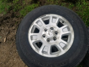Selling 4 17 inch gmc rims and tires
