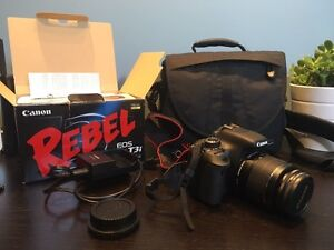 Canon T3i with 18-55mm lens and bag