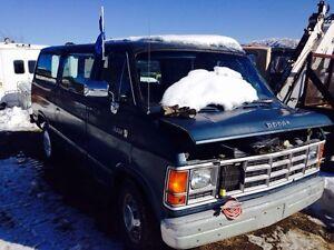 1989 Dodge 15 passenger van and a 1995 Eagle Visson 4 door car