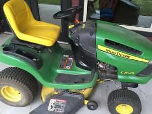 John Deere riding mower tractor, low hours, works great, moving