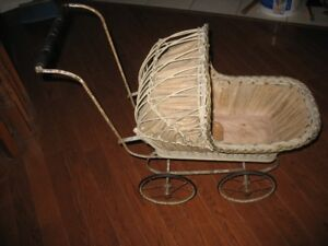 Antique doll buggy.