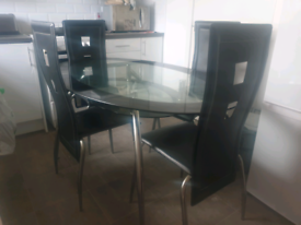 Dining table,4 comfortable leather chairs