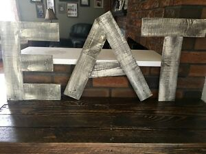 """Rustic reclaimed pallet wood """"eat"""" sign"""