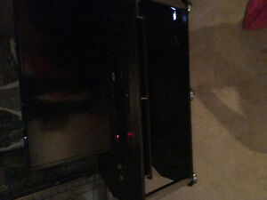 Like new black and chrome TV stand