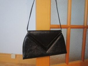 SEVERAL PURSES , WALLETS & HAND BAG