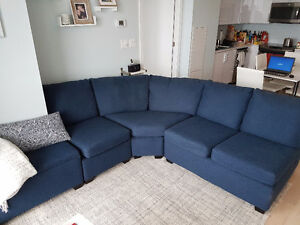 Sectional navy blue couch with ottoman