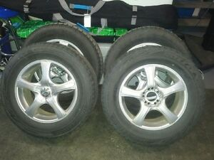 "Four 17"" winter tires and alloy rims - used less than 5,000 KM"