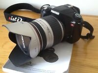 Pentax *ist DL SLR Digital Camera with SIGMA Aspherical IF 28-300mm Lens.