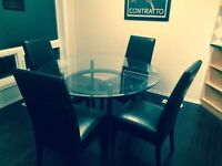 Glass topped Table and 4 brown leather chairs