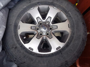 4 Ford F150 stock rims and tires