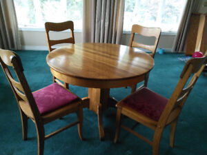 Solid Tiger Oak dining table and four chairs