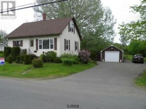 Large lot, private yard, large deck, new windows,well maintained