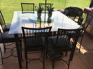Like new GLASS PATIO table EIGHT CHAIRS