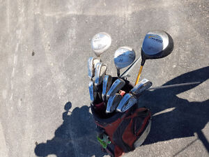 Multiple sets of golf clubs