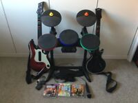 PS3 rock band set. Drums + 2 guitars + mic + 3 games
