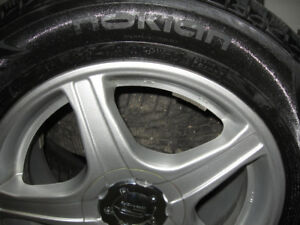 4- NOKIAN 215/65/16 winter grips on Core Racing mags