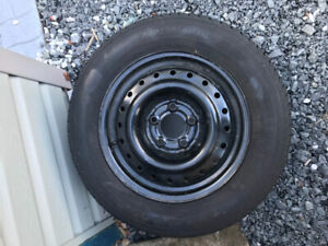 Full size spare tire on rim