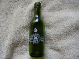 a CONSUMERS GLASS 30th Anniversary bottle