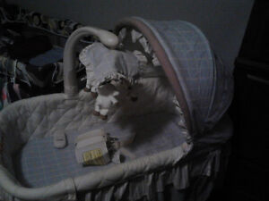 Lightly used bassinet that viberates, sings, and lights up
