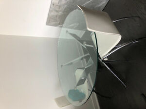Glass dining table that comfortably fits 4