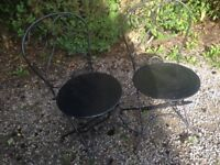 2 old Wrought Iron garden chairs.