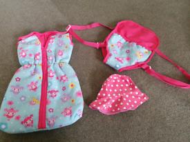 Baby doll carrier, sleeping bag and waterproof rain hat