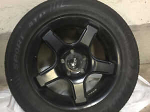 225/55 ZR16 performance tires on 16x7 rims with 5x112 bolt pat
