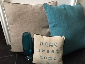 Cushions and teal vase