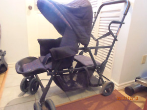 Baby buggy with extra seat