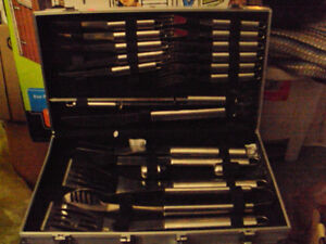 a brand new cond 21 piece bbq set in siver metal anvil case