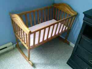 Baby cradle solid wood with mattress. In excellent condition. As