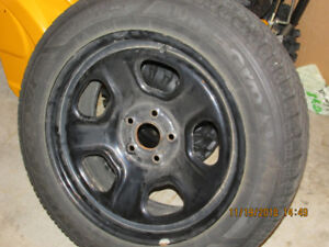 4 tires with rims off of a 2014 Ford Taurus. Goodyear snow tires