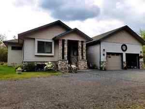 Custom built home with acreage for sale