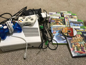 Xbox 360 with games and remotes