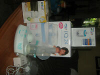 Ameda double breast pump, Phillips bottle sterilizer and warmer