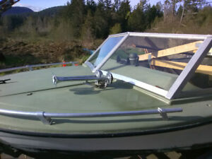 Boat with two vintage outboard Mercury 500 thunderbolts
