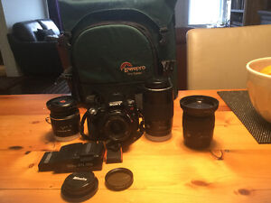 Sony a55 + 4 lenses, filter, backpack; Sony a55 + 4 objectifs