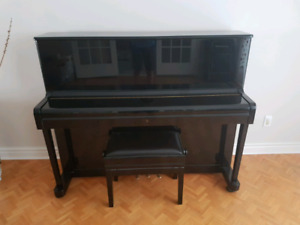 Upright Petrof piano with piano bench