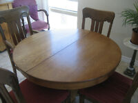 antique round solid oak dining table and chairs