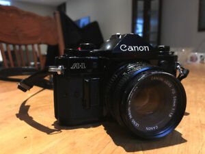 Canon A-1 with 2 lenses and Flash