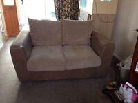 Two seater sofa in mushroom jumbo cord
