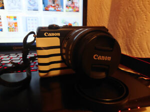 Canon M100 with Face Jacket Border Blue