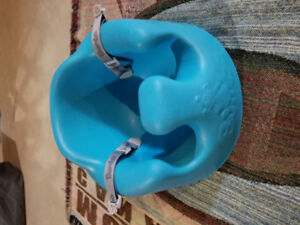 Bumbo chair with straps.