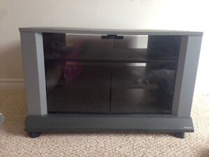 "32"" wide,  3 shelf, glass door on wheels."