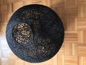 A resin drained glass-fiber yarn is randomly coiled around a big