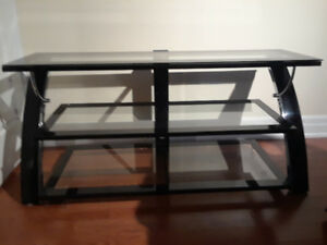 flat screen television stand. three gless shelves. ( was 200 new
